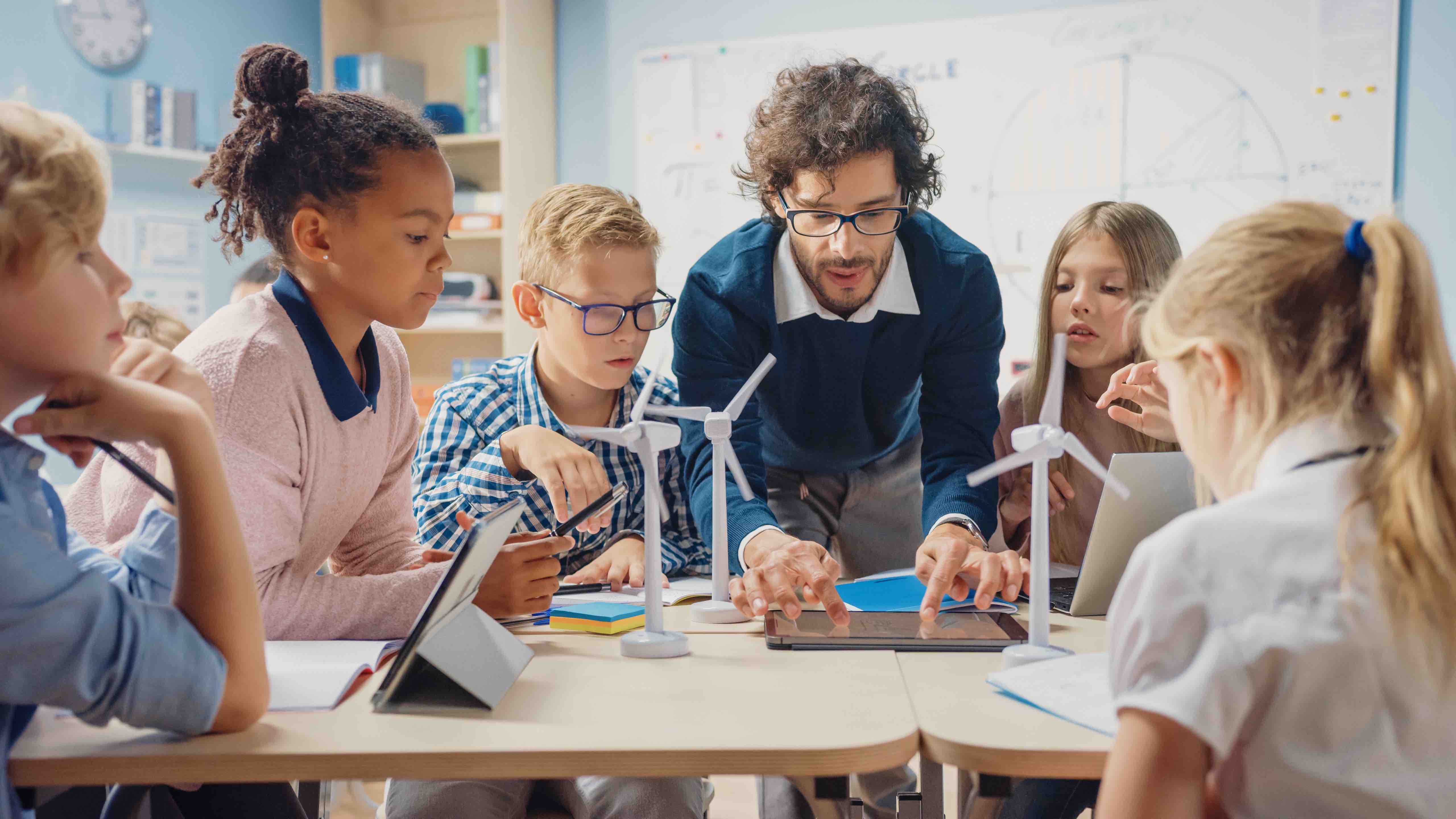 male teacher teaching students